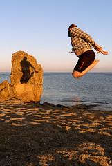 Random beach jumping photo by adammlewis
