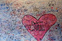 Graffiti-covered wall @Verona photo by Copel.K
