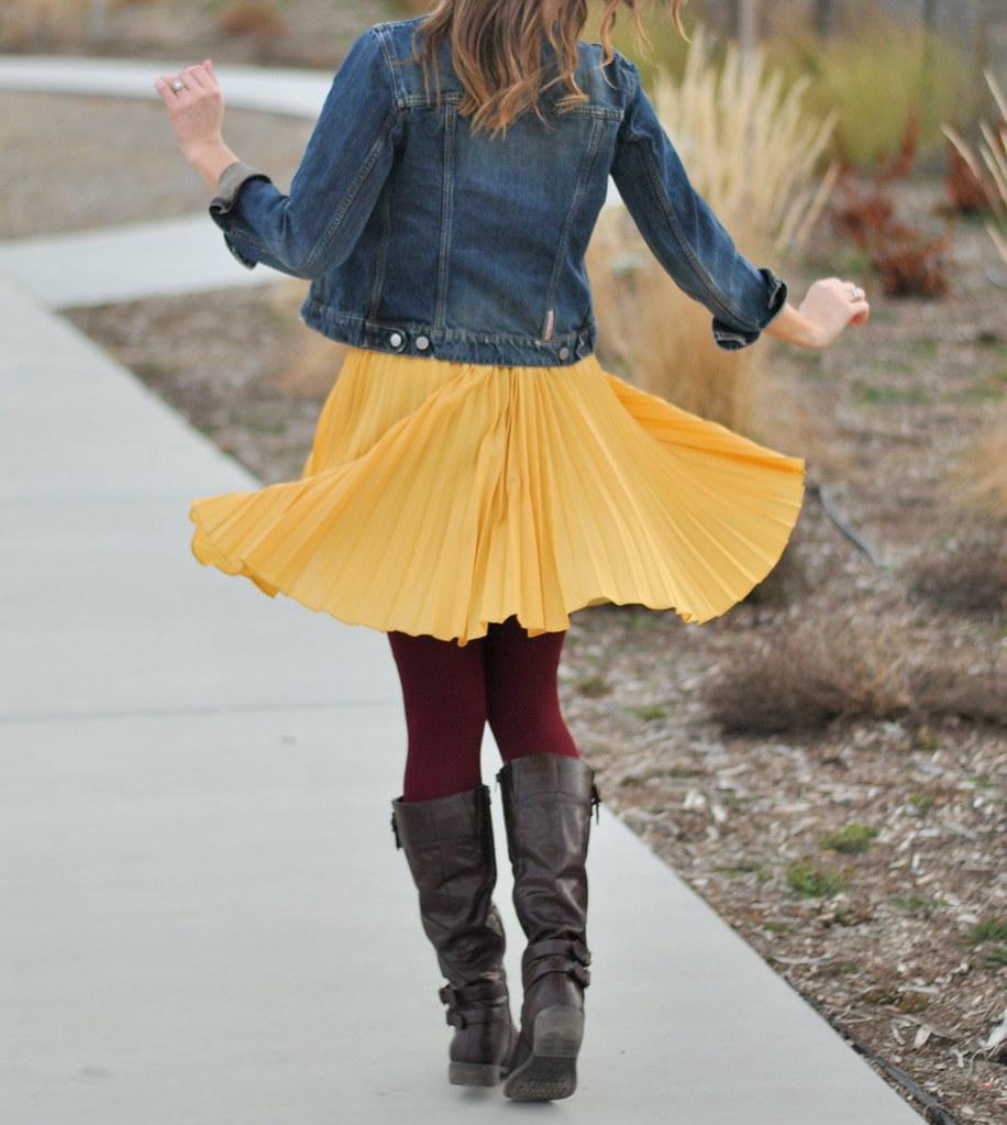 denim jacket + yellow skirt + maroon tights + boots