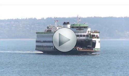 ferry still w play button