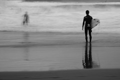 Surfer's silhouettes photo by **sione**