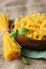 Uncooked gluten free pasta from blend of corn and rice flour photo by Iryna Melnyk