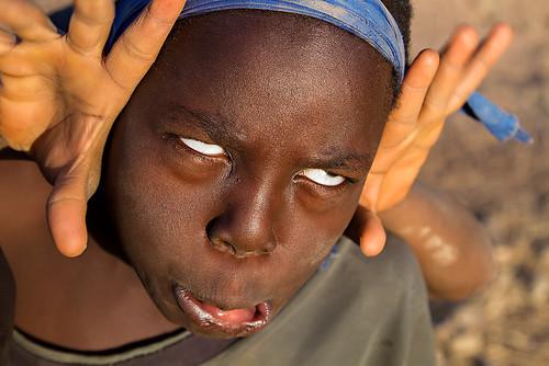 Boy playing in the streets of Ougadougou, Burkina Faso.