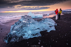 Blue ice at Jökulsárlón beach photo by NaphakM