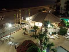 Night shot of pool area.