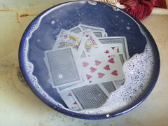 cards murkily visible through soapy water
