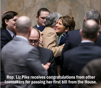 Rep. Liz Pike congratulated for passing first bill