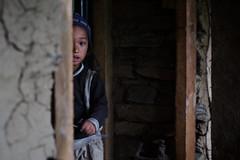 Nepali child in mountain village near Manaslu, Gorka area, Nepal photo by Alex_Saurel