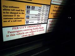 Ejecting bodily fluids warning, taxi, SXSW, Austin, TX, USA photo by gruntzooki