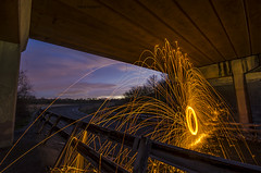 A banked curve, a bridge and a lot of sparks photo by Adam Kennedy Photography