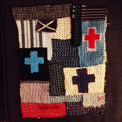 abstract running stitch and cross fabric collge photo by peregrine blue