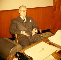Business Executive with Desk - 1953 Color Slide photo by Mike Leavenworth
