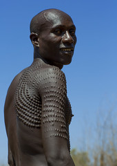 Topossa Man With Scarifications On His Body, Kangate, Omo Valley, Ethiopia photo by Eric Lafforgue