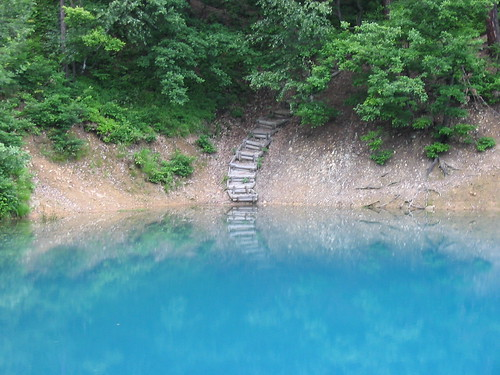 Stairs from a blue lake