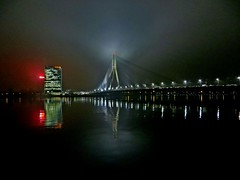 Suspension Bridge over river Daugava in Riga, Latvia. November 11, 2014 photo by Vadiroma