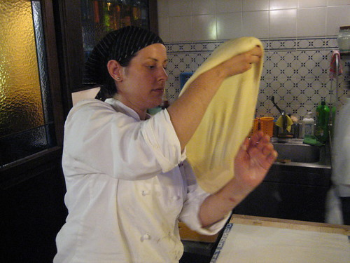 stretching the strudel dough