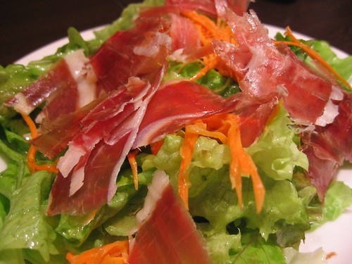 salad topped with parma ham