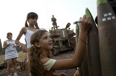 Israeli girls sign gifts for Lebanese