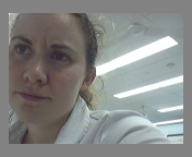 Pia on the lab's webcam, fiddling with its server