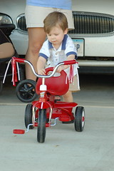 Ean pushing his new tricycle