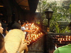 Devotees light candles inside the basilica