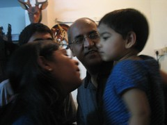 Giving Janani atthai a kiss while Babu thatha eagerly waits his turn