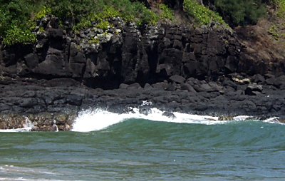 The black volcanic rocks around Kalihiwai Beach