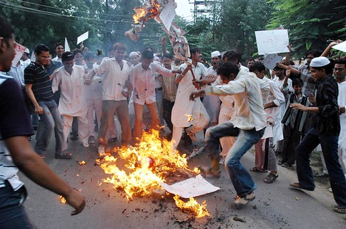 Muslim activists burn an effigy of Pope Benedict XVI during a protest in Srinagar, India
