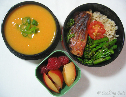 [bento bowl set with gingery sweet potato soup in one tier, salmon, broccolini, and brown rice in 2ns tier, fruit in a side bento]