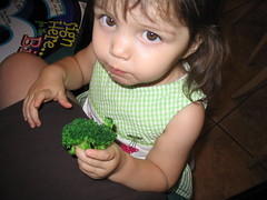 Amber eating broccoli