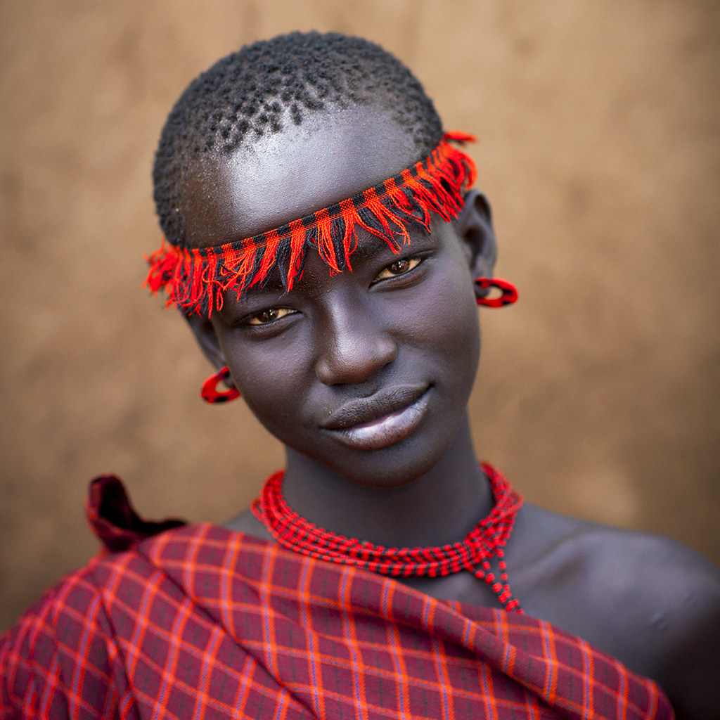 Miss Domoget, Bodi Tribe Woman With Headband, Hana Mursi, Omo Valley, Ethiopia photo by Eric Lafforgue