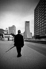 Bogotá, Carrera Séptima - Un hombre espera photo by RoryO'Bryen