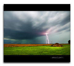 Violet electric lightning versus turquoise storm - 09072012 photo by StormLoverSwin93
