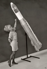 ... woman with model of Atlas ICBM photo by x-ray delta one