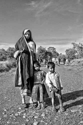 Toranmal Photography - A Mother and Two Children and a Flock of Cows - Monochrome photo by Anoop Negi
