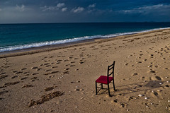 Alone on the beach photo by Timos L