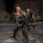 Laertes (Timothy Edward Kane), Hamlet (Scott Parkinson) and Horatio (Kareem Bandealy), with Claudius (Michael Canavan) in background in HAMLET at Writers' Theatre. Photo by Michael Brosilow.