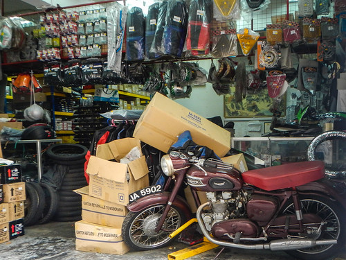 Motorcycle Repair Shop with Old Triumph
