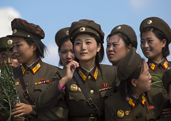 Smiling North Korean Female Soldiers In Tower Of The Juche Idea, Pyongyang, North Korea photo by Eric Lafforgue