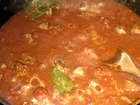 Add stock,tomatoes & boil (light)