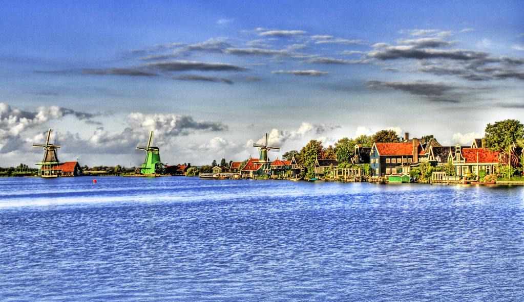 Dutch Windmills Across the Lake