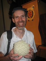 Paul Kates holding a quasicrystal construction.
