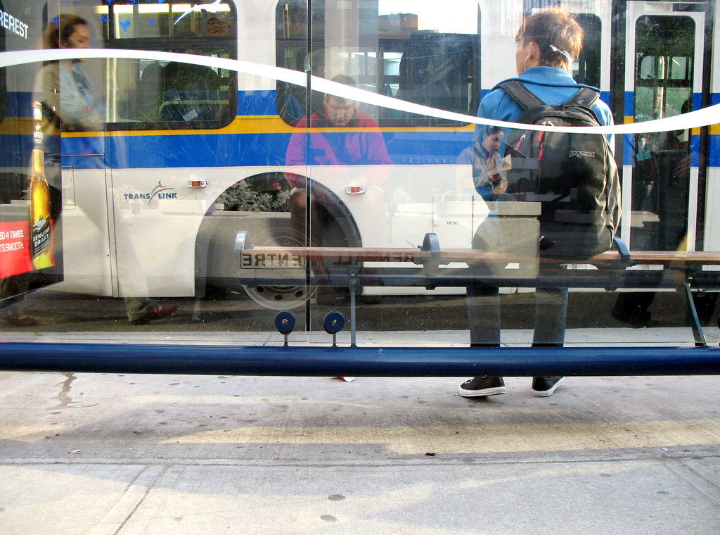 reflected lives @ the bus stop
