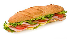 Footlong ham & swiss submarine sandwich isolated on white photo by PABLODELICES