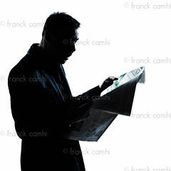 silhouette man portrait reading newspaper surprised photo by Franck Camhi
