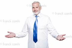 man senior getting dressed tying windsor necktie photo by Franck Camhi