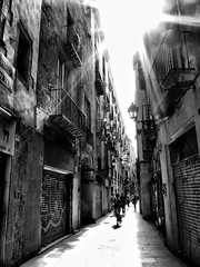 Rays of light through the narrow alleys of Barcelona photo by jimiliop