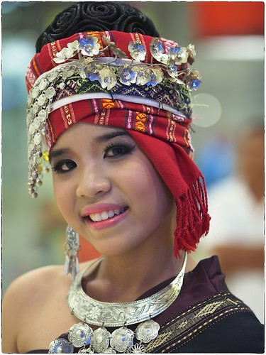 Young northeastern lady in festive outfit photo by rogerml