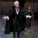 Polonius (Ross Lehman) and Ophelia (Liesel Matthews) in background in HAMLET at Writers' Theatre. Photo by Michael Brosilow.