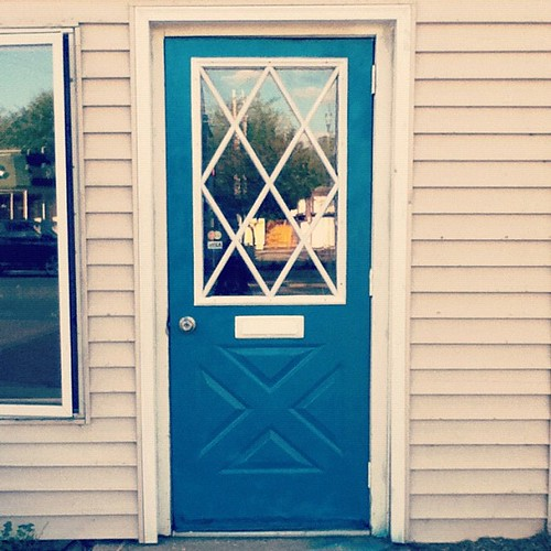 I painted the shop door turquoise! :)